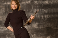 smiling woman with oboe