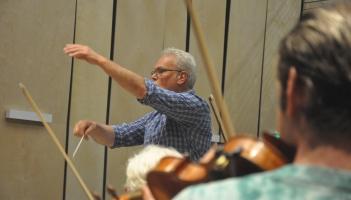 man conducting orchestra